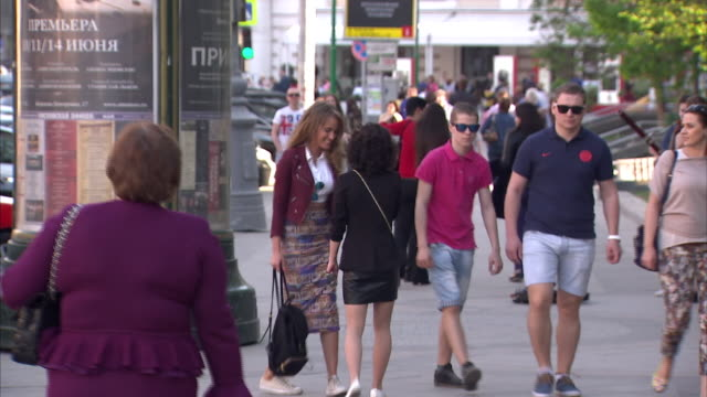 exterior shots of shoppers walking in a pedestrianised area past designer shops on 1 april 2014 in moscow, russia - デザイナー服点の映像素材/bロール