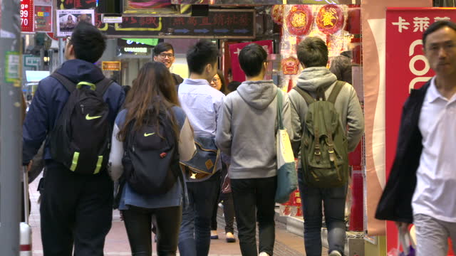 exterior shots of shoppers walking through the centre of hong kong past various shops including soft focus generic anonymous shots and shots of the... - book shop stock videos & royalty-free footage