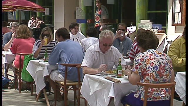 exterior shots of shops and restaurants around oxford street, and streetscenes of people eating al fresco and smokers on july 3, 1993 in london,... - young adult stock videos & royalty-free footage