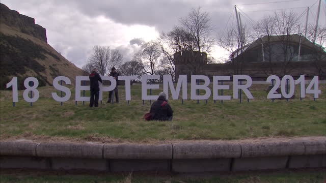 exterior shots of sign erected in holyrood park of 18th september 2014 showing the date of the independence referendum date set for 2014 scottish... - scotland stock videos & royalty-free footage