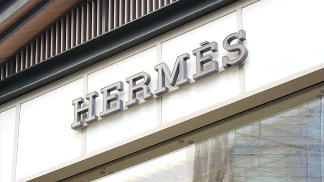 exterior shots of signage for various designer stores in chengdu including cartier hermes jimmy choo miu miu gucci and omega>> on september 24 2015... - hermes designer label stock videos and b-roll footage