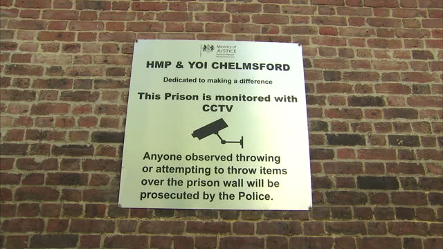 Exterior shots of signage outside HMP Chelmsford warning of attempts to throw items over the wall being captured by CCTV on 17 April 2017 in...