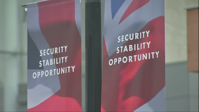 Exterior shots of signage outside the Manchester Central convention centre during the Conservative party conference with the slogan Security...