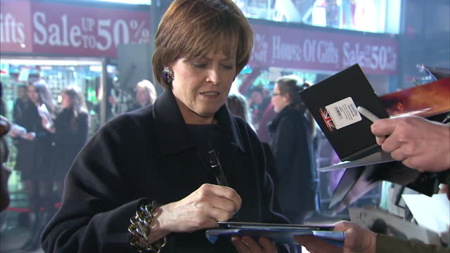 exterior shots of sigourney weaver signing autographs at paul premiere film premiere of paul at leicester square on february 07 2011 in london england - 40 seconds or greater stock videos & royalty-free footage