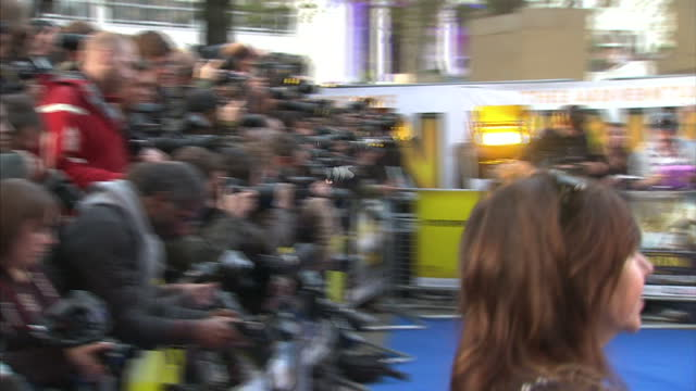 Exterior shots of Simon Pegg and Nick Frost posing for photos on blue carpet of Tintin Film Premiere with media and paparazzi taking photos of them...