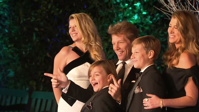 Exterior shots of singer Jon Bon Jovi posing with his family on the blue carpet at the Winter Whites gala at Kensington palace Prince William attends...