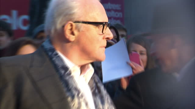 exterior shots of sir anthony hopkins arriving on red carpet posing with wife stella arroyave and younger woman close ups of anthony hopkins wearing... - anthony hopkins stock videos & royalty-free footage