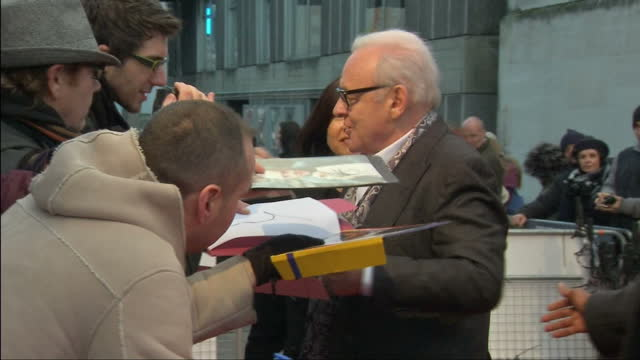 Exterior shots of Sir Anthony Hopkins arriving on red carpet signing autographs for fans behind barriers Film premiere of Hitchcock about the love...