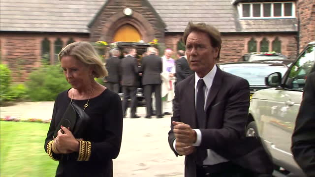 exterior shots of sir cliff richard arriving at cilla black's funeral and shots of family members standing outside of church on august 20 2015 in... - cliff richard stock videos and b-roll footage
