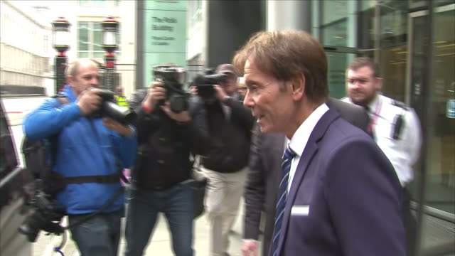 exterior shots of sir cliff richard walking from court and departing in a taxi during his bid to sue the bbc over coverage of a raid on his house in... - cliff richard stock videos and b-roll footage