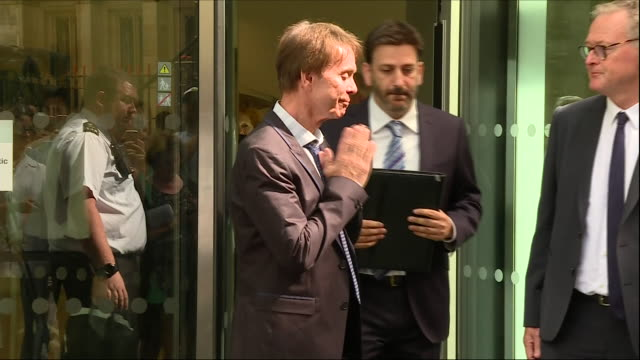 exterior shots of sir cliff richard with his lawyer, gideon benaim, holding press conference outside the rolls building after a judge ruled in his... - judge entertainment stock videos & royalty-free footage