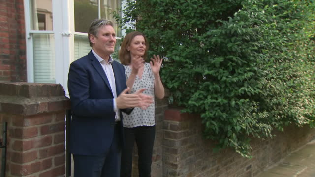 exterior shots of sir keir starmer with wife victoria starmer clapping for nhs, carers and key workers in a weekly moment of appreciation at 8pm... - keir starmer stock videos & royalty-free footage