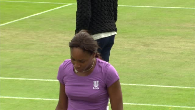exterior shots of sisters serena williams and venus williams practicing on court at wimbledon on 19 june 2010 in london united kingdom - 2010 2019 stock videos & royalty-free footage
