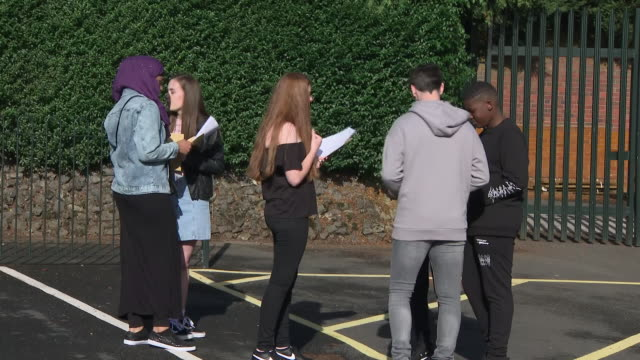 exterior shots of small groups of students stood around in school car park opening their gcse results on 20 august 2020 in oldbury, united kingdom - general certificate of secondary education stock videos & royalty-free footage
