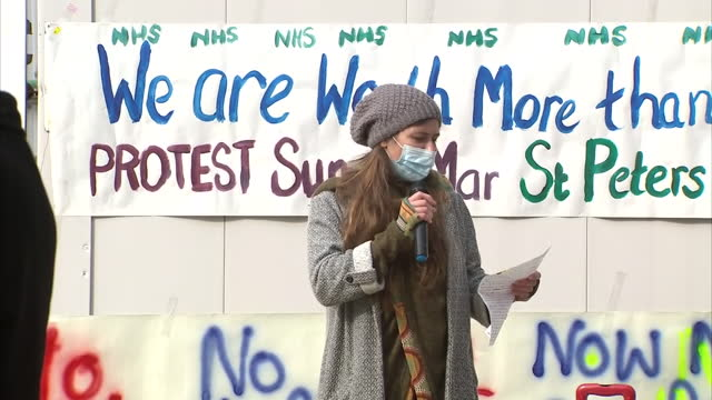 exterior shots of small number of protesters gathered at protest against nhs workers only getting a 1% pay rise shots of people giving speeches and... - paying stock videos & royalty-free footage