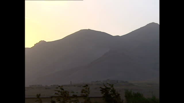 exterior shots of smoke billowing over a mountainside in the jabal saraj district of afghanistan, with some flashes from weapons fire seen.>> on... - war stock-videos und b-roll-filmmaterial
