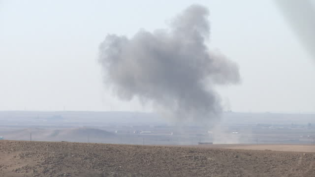 exterior shots of smoke rising from an airstrike against an islamic state target in the distance, seen from a ypg position near ayn issa.>> on... - 2015 stock videos & royalty-free footage