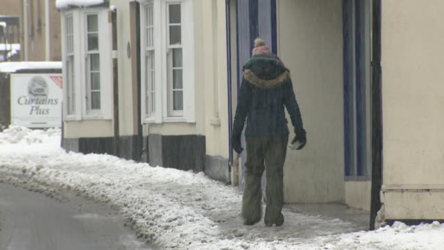 exterior shots of snow covered uk town winter street scenes on 1st february 2019 in farrigton england - winter stock videos & royalty-free footage