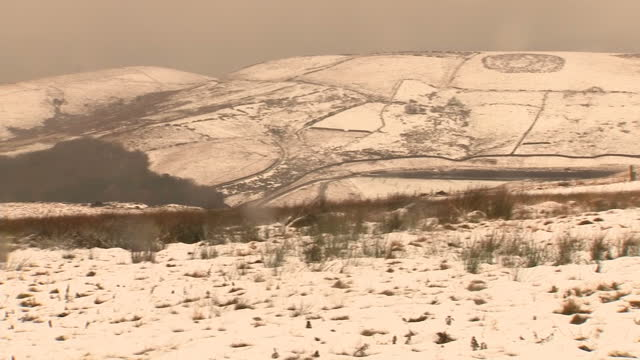 Exterior shots of snow covering Saddleworth Moor with flecks of rain or sleet settling on the camera lens on November 26 2017 in Oldham England