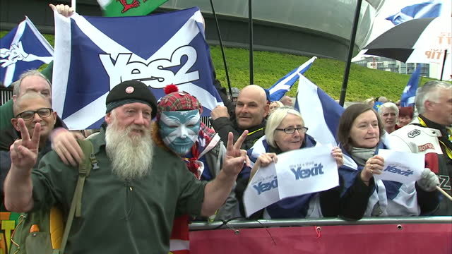 exterior shots of snp supporters in a motorcycle parade with scottish flags during the snp conference on october 15, 2016 in glasgow, scotland. - patriotism stock videos & royalty-free footage