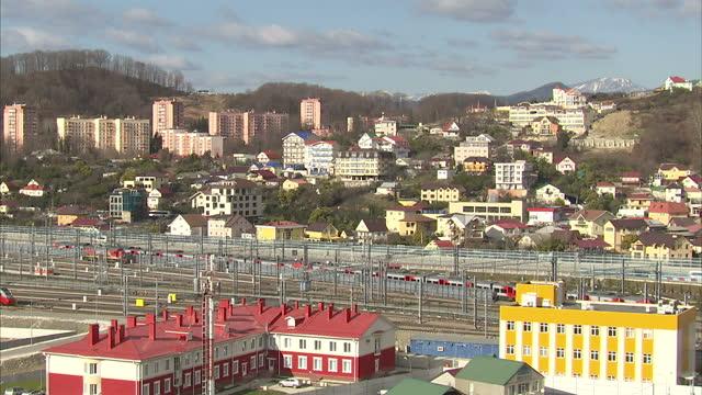 vídeos y material grabado en eventos de stock de exterior shots of sochi looking towards the mountains>> on february 05 2014 in sochi russia - sochi