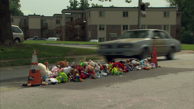 Exterior shots of soft toys and tributes in a street in Ferguson one year after the shooting of teenage Michael Brown on August 10 2015 in Ferguson...