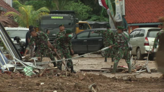 exterior shots of soldiers and diggers moving rubble following the devastating tsunami few days before christmas on 25 december 2018 in carita banten... - moving after stock videos & royalty-free footage