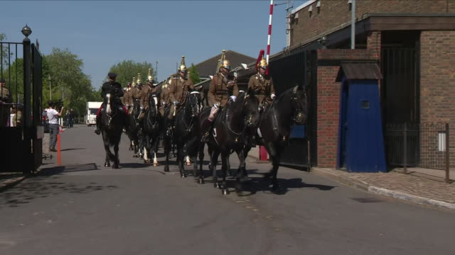 Exterior shots of soldiers from The Household Cavalry leaving Combermere Barracks for the military procession rehearsal for Prince Harry and Meghan...