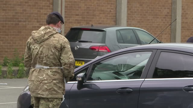 exterior shots of soldiers in ppe testing members of the public for coronavirus at a drive through testing centre on 29 june 2020 in leicester united... - army stock videos & royalty-free footage
