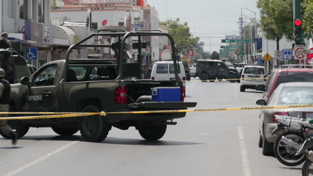 Exterior shots of soldiers in the streets of Nuevo Laredo manning a security cordon in the street as local people watch on on September 08 2016 in...