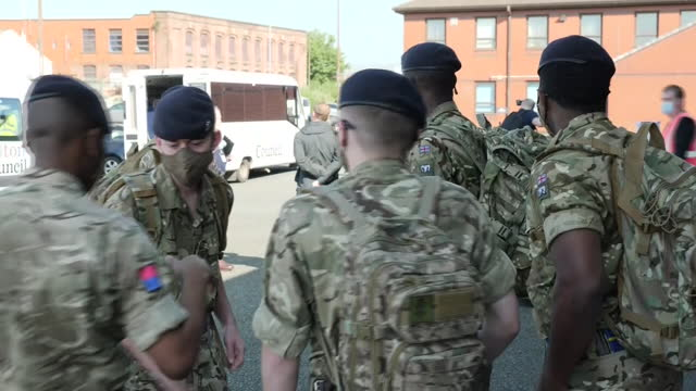 exterior shots of soldiers preparing boxes and trolleys as the government call in the army to help support surge coronavirus testing in bolton on the... - army soldier stock videos & royalty-free footage