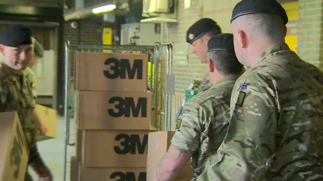 exterior shots of soldiers unloading 3m ppe equipment supplies from army lorry onto loading dock at st thomas' hospital to help during the... - army stock videos & royalty-free footage