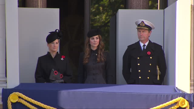 exterior shots of sophie, countess of wessex, catherine, duchess of cambridge and vice admiral sir timothy laurence standing on a balcony as the... - remembrance sunday stock videos & royalty-free footage