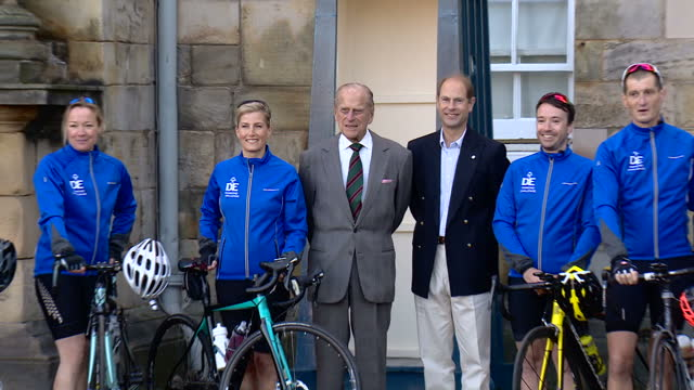 Exterior shots of Sophie Countess of Wessex pose for photos with Prince Philip Duke of Edinburgh and Prince Edward Earl of Wessex ahead of her cycle...