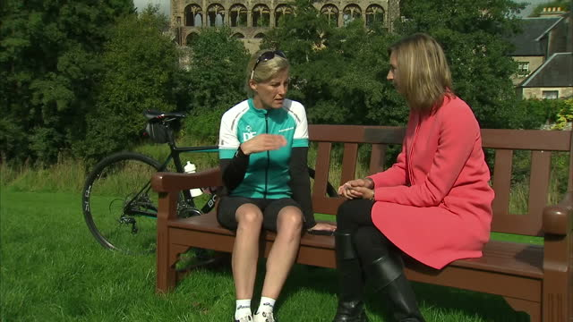 exterior shots of sophie, countess of wessex talking to reporters and shots of her holding a box of cakes after her first day of cycling form... - ジェドバラ点の映像素材/bロール