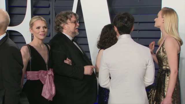 exterior shots of sophie turner and joe jonas talking to guillermo del toro and kim morgan on the red carpet of the 2019 vanity fair oscar party on... - vanity fair oscar party stock videos & royalty-free footage