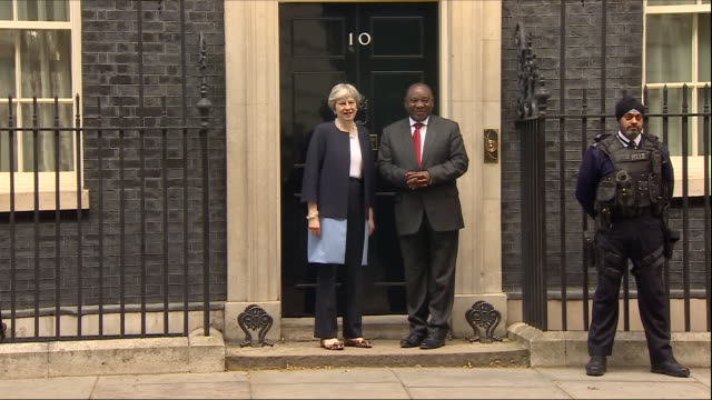 exterior shots of south african president cyril ramaphosa walking from car to door of 10 downing street where he is greeted by uk prime minister... - 10 downing street stock videos and b-roll footage