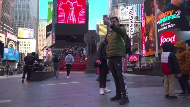 exterior shots of sparse crowds of tourists around times square some wearing face masks and a theatre showing chicago on 16 march 2020 in new york... - times square manhattan stock videos & royalty-free footage