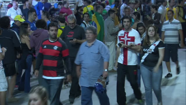 Exterior shots of spectators walking about the Barra Olympic Park at night on August 14 2016 in Rio de Janeiro Brazil