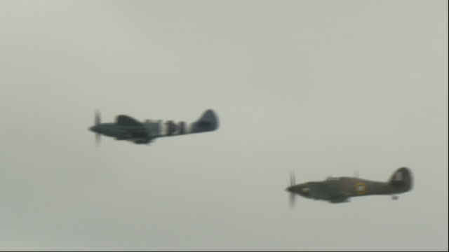 exterior shots of spitfire, hurricane and dakotas fly during an event to commemorate the 75th anniversary of the d-day landings on 05 june 2019 in... - anniversary stock videos & royalty-free footage