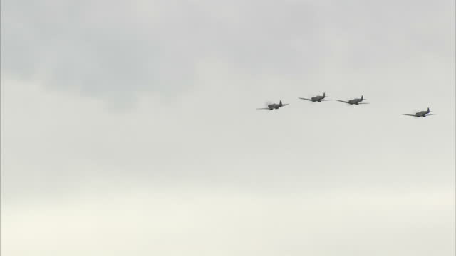 exterior shots of spitfires flying at the battle of britain 75 year anniversary at biggin hill on august 18, 2015 in kent, england. - biggin hill stock videos & royalty-free footage