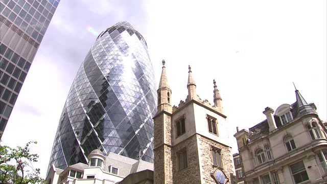 exterior shots of st andrew undershaft church in front of the gherkin building in london st andrew undershaft church in london on july 26 2013 in... - swiss re stock videos & royalty-free footage