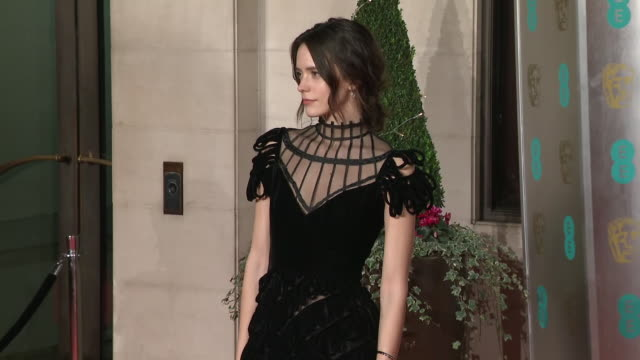 exterior shots of stacy martin on the bafta after party red carpet wearing a black tiered dior gown on 10th february 2019 in london england n - 英国アカデミー映画賞点の映像素材/bロール