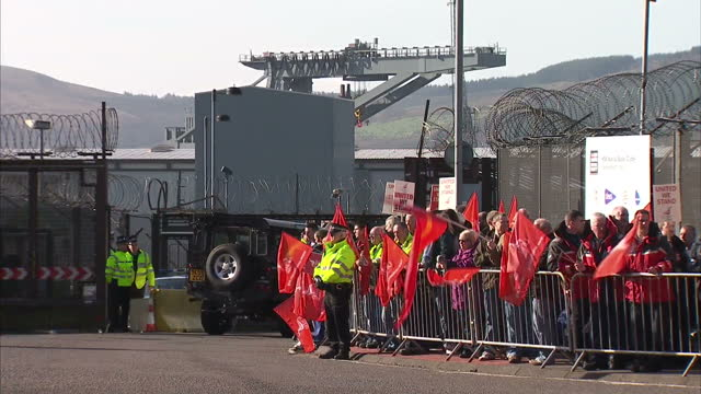 exterior shots of staff from faslane nuclear naval base carrying unite flags on a march over disputes in pay on march 11, 2014 at faslane, scotland. - unity stock videos & royalty-free footage