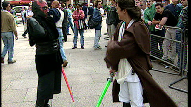 exterior shots of star wars fans dressed as characters fighting with light sabers at the premiere of star wars episode i: the phantom menace at... - premiere stock videos & royalty-free footage