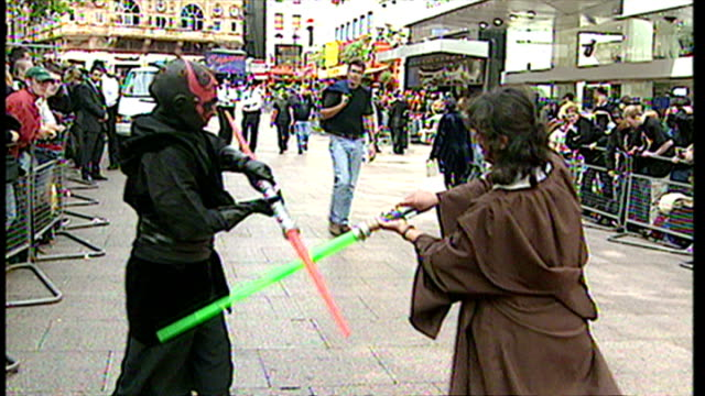 exterior shots of star wars fans dressed as characters fighting with light sabers at the premiere of star wars episode i the phantom menace at... - star wars stock videos & royalty-free footage