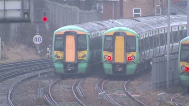 exterior shots of stationary southern rail trains at horsham train station during industrial action on december 13 2016 in london united kingdom - strike industrial action stock videos & royalty-free footage