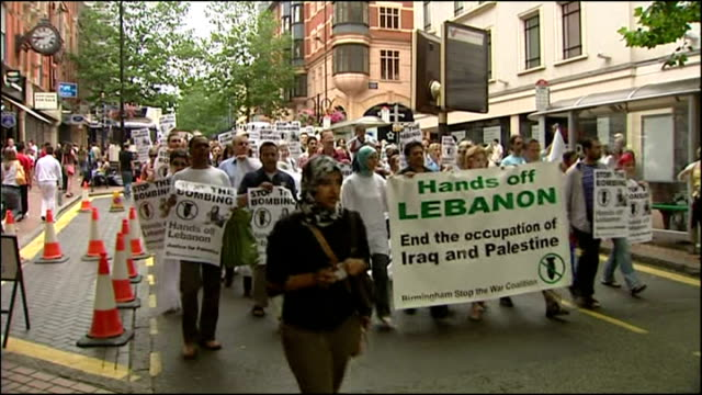 exterior shots of stop the war demonstrators in london protesting against israel's military action against hizbollah targets in lebanon on july 22... - 2006 stock videos & royalty-free footage