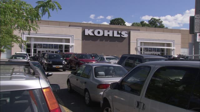 exterior shots of store showing cars parked in parking lot and customers entering the store cu on signage kohl's department store on central park ave... - kohls stock videos & royalty-free footage
