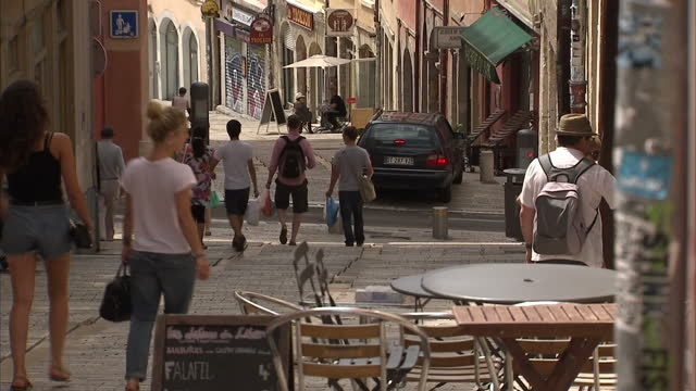 exterior shots of street scenes around lyon with people strolling around bars coffee shops and the river rhone with bridges over it on july 05 2016... - olympique lyonnais stock videos and b-roll footage